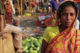 A woman at a market in Bangladesh. A new book shows that the growth of microfinance institutions over two decades in Bangladesh has helped the rural poor diversify their economic activities and boost incomes, lifting some 2.5 million people out of poverty.